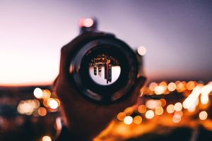 looking at a busy city through a camera lens